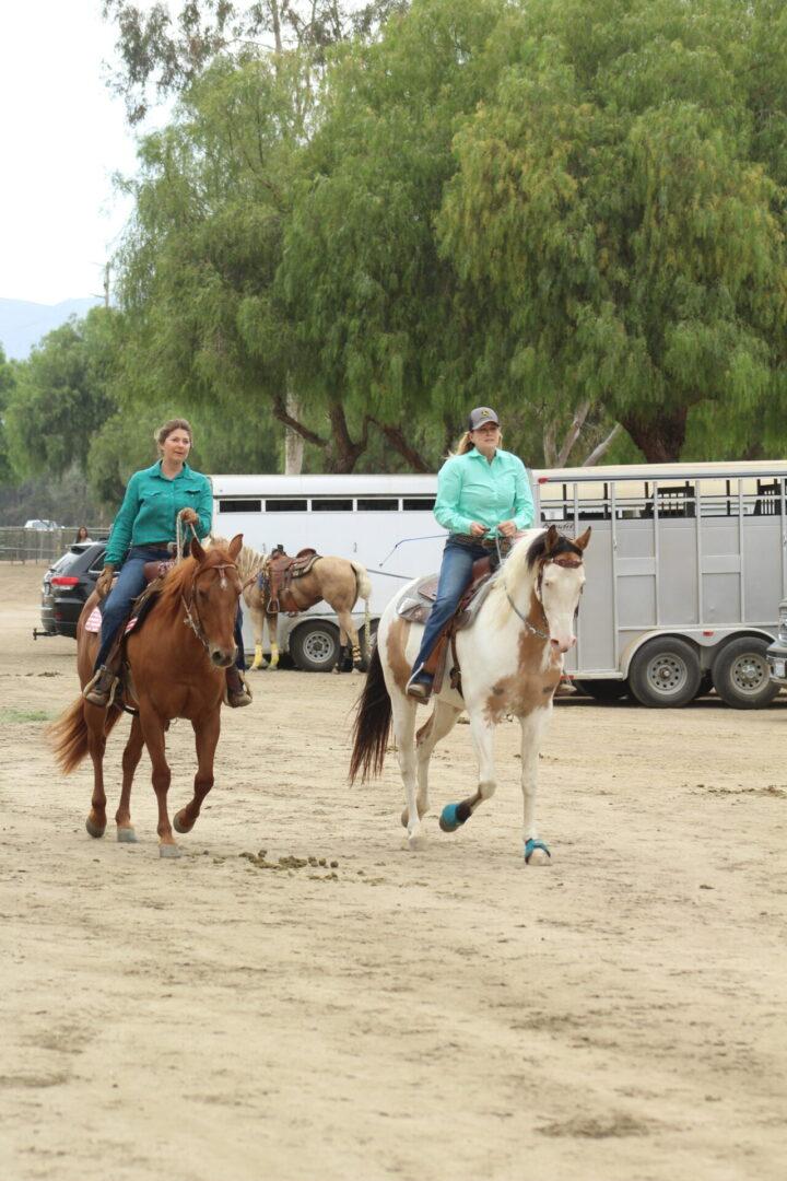 Two women riding horses